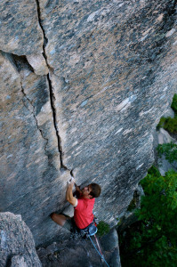 ​Seth Petit getting into the dreamy locks of Emigrant Crack (5.10b), South Wall. Photo by Grant Simmons.