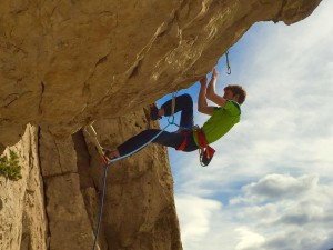 John Morrison working his way out the steep roof on Butch 5.12c at The Hideout Wall at the Upper Bridge Bands.