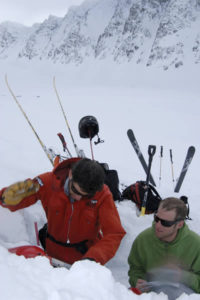 Nate Greenberg and Lorenzo Worster look at the snowpack.