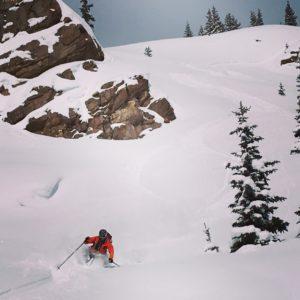 Friends enjoying playful terrain after a classic Colorado storm.