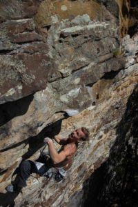Adam Henry at home on the steep sandstone of the Little River Canyon. Photo from Micah Gentry collection.