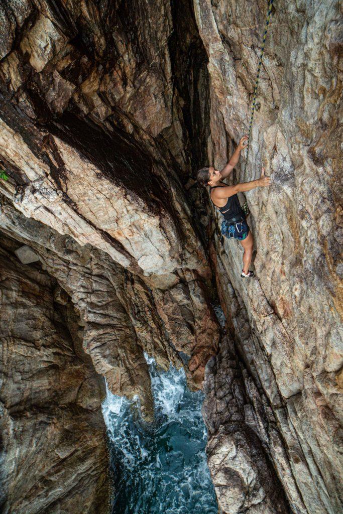 Rachal Fagan climbing Forewarned (6a) at Lang Khai. Photo by Kelsey Gray.