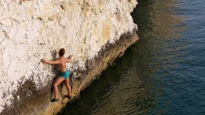 Janna on Crimpy Traverse V0, Ras al Hamra.